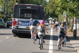 Notice in this shot the different reactions from riders as the bus signals it's intention to go right over the bike lane.